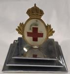 Paperweight featuring Red Cross emblem