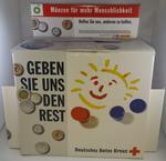 Large cardboard collecting box: 'Munzen fur mehr Menschlichkeit'
