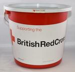 Red plastic British Red Cross collecting bucket