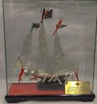 Silver model of a boat in a presentation box gifted by Hong Kong Red Cross, 1997