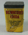 Empty tin with yellow paper label and 'Rowntrees Cocoa' in relief on lid and base. Part of a collection of items which were never sent but used at the POW Exhibitions which were held during the Second World War.