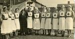 Group of VADs including Geraldine Clay wearing Indoor Uniform outside a Recruitment Tent at a School Fete in Coulsdon