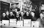 Prisoners of War from Ilag VIII displaying Red Cross food parcels and tins