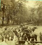 Nurses and [orderlies] with horse drawn ambulances bearing patients