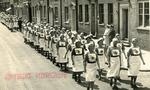 Groups of VADs from the Farnham Division, Surrey marching in the Street