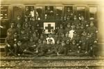 VADs, male members beside ambulance train