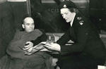 Black and white photograph of a British Red Cross Society member attending to a patient