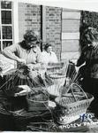 Black and white photograph of basket weaving activity at Barnett Hill