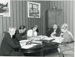 Black and white photograph of NHQ delegation discussing plans to attend the League Board of Govenors meeting in Mexico