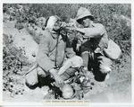 Black and white photograph of a 13th Hussar and a wounded Turkish soldier during the First World War