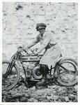 Black and white photograph featuring a female Red Cross despatch rider