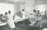 Black and white photograph of the Red Cross trolley at Colony Central Hospital Tanawa