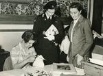 Photograph of a Young Girl demonstrating her work to Princess Alexandra