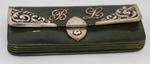 Green leather purse with the initials B.L.