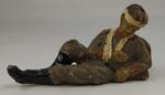 Small model of wounded and bandaged soldier